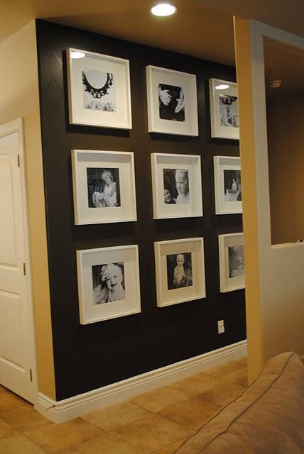 Black Accent Wall with Photo Frames