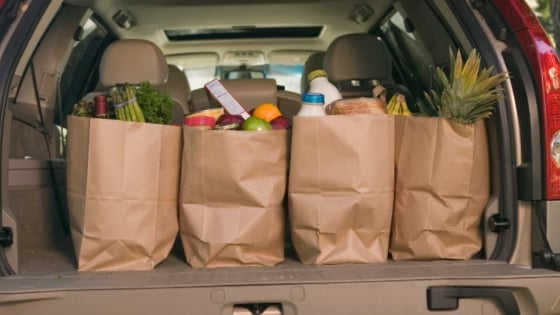 buy groceries for a food pantry - groceries in the back of an suv
