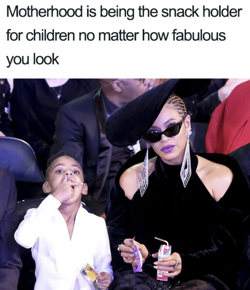 Motherhood is being the snack holder for children no matter how fabulous you look.